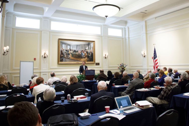 Dr. Matthew Spalding speaking at a Lifelong Learning Seminar in Washington D.C.